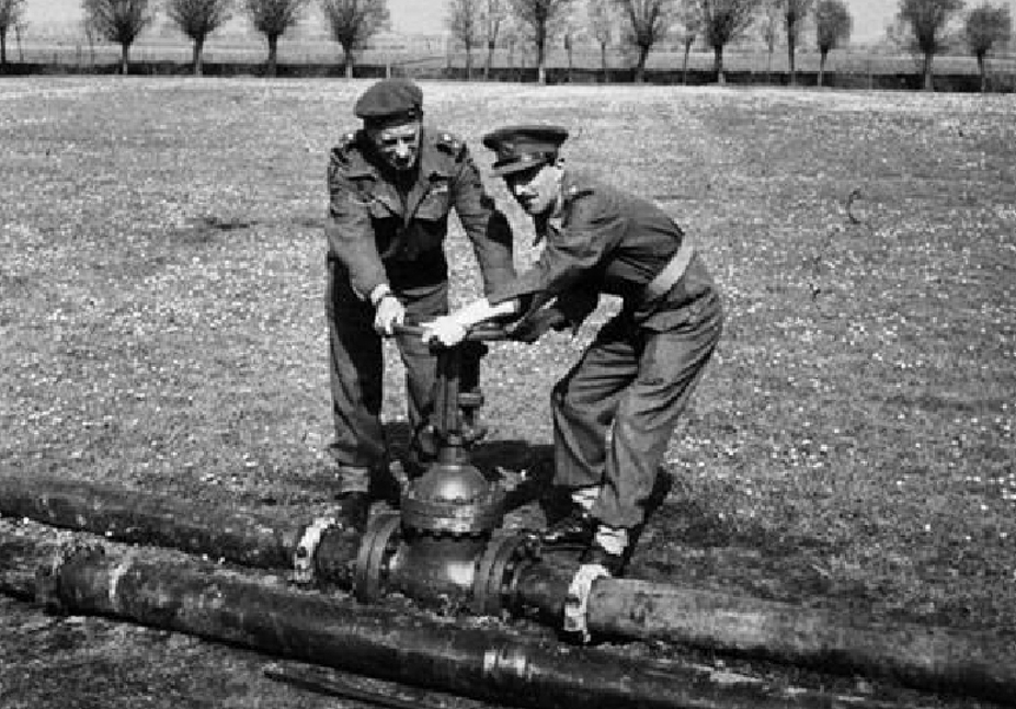 Picture of soldiers opening valve